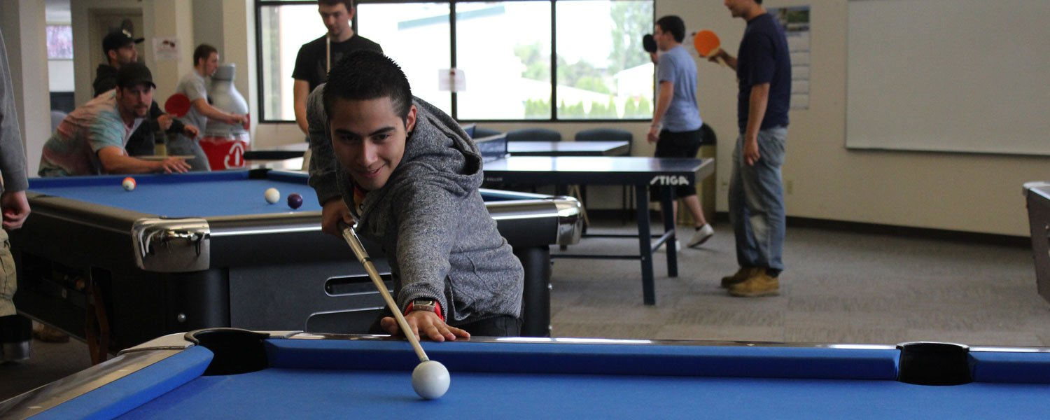 Student playing pool in Student Activity Center SAC